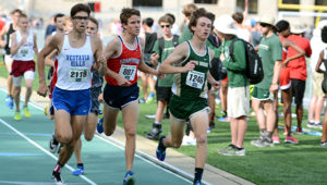 Vestavia Hills' James Sweeney, Homewood's Will Stone and Mountain Brook's Charlie Slaughter battle at the front of the boys 1 mile race on Saturday afternoon at the Mountain Brook Invitational.