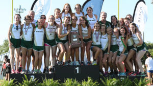 Members of the girls team pose with the trophy.