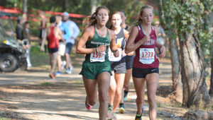 Mountain Brook High School senior Anna Balzli, left, is the top runner on a Spartan girls cross-country team aiming to recapture the Class 7A state title.