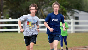 Mountain Brook High School cross-country runners Charlie Slaughter, left, and Hunter Harwell, right, participate in a workout at Veterans Park in Hoover. Both have overcome injuries that threatened to impact — or in Slaughter's case, wipe out — their seasons.