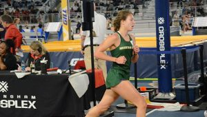 Anna Balzli competing in the 3200 at State Indoor Championships